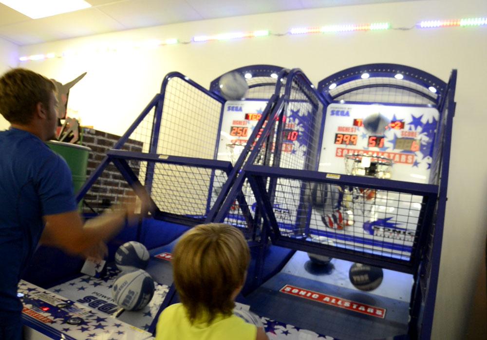Boys Competing At Bsaketball Arcade Game