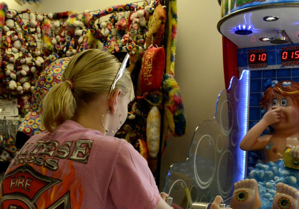 Girl Playing Arcade Game