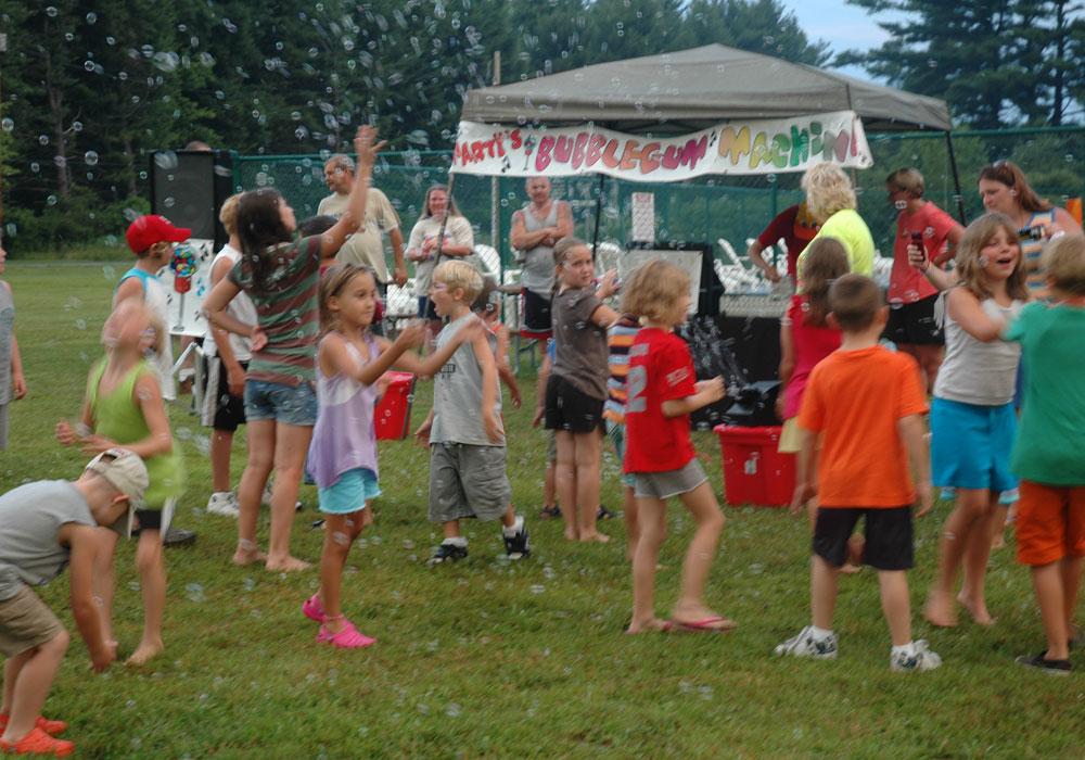 Kids Playing Around Bubble Machine