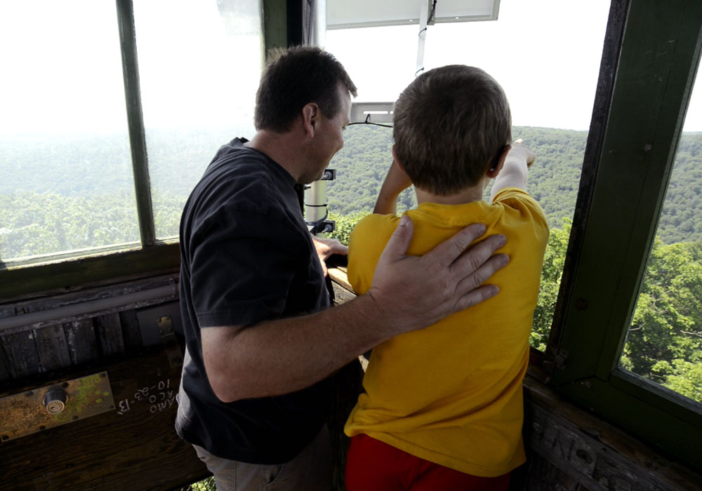 Father & Son Looking Out From Fire Tower