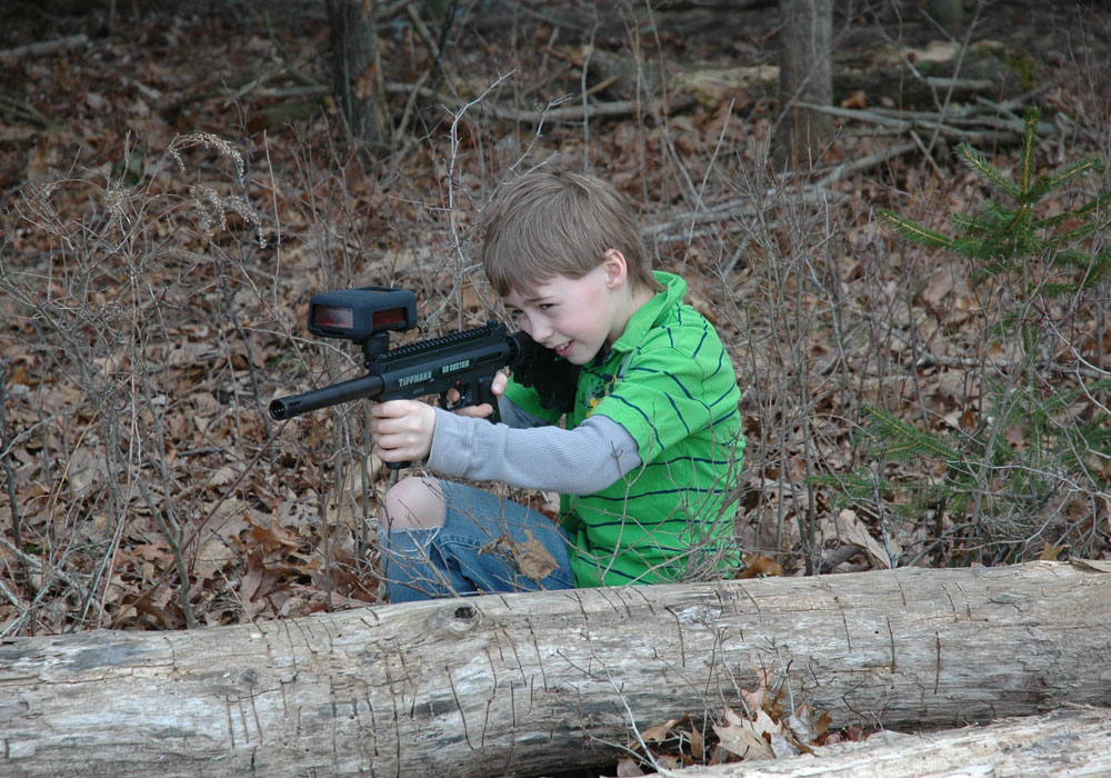 Young Boy Playing Laser Tag