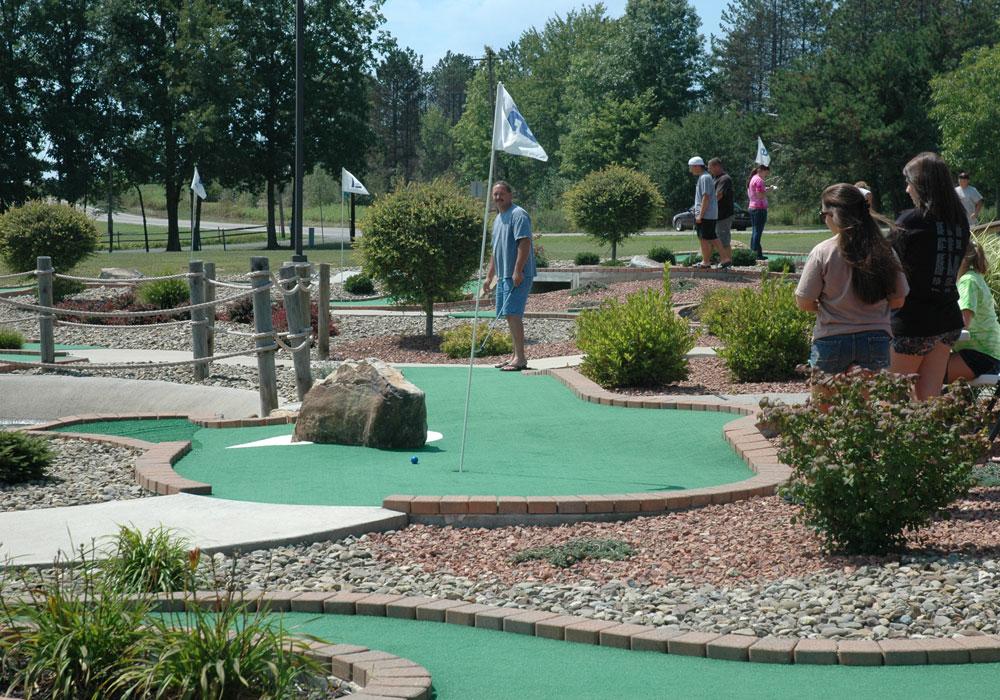 Guests Enjoying Mini Golf