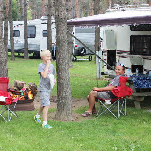 Father & Son At RV Hook Up SIte
