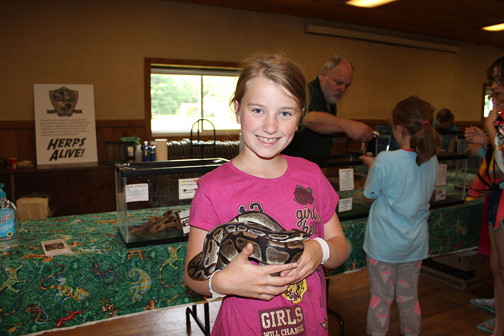 Indoor Safari - Girl Holding Snake
